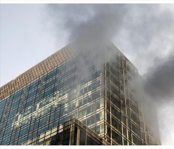 Smoke coming out of an eight-story building